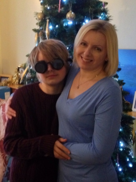 A normal family photo - Son2 with his goggles